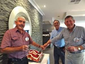 Three of the founding members cutting our 22nd birthday cake