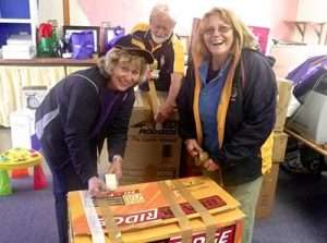Vicki, Brian and Yvonne packing donated clothes and toys for delivery to Vanuatu following a recent cyclone.