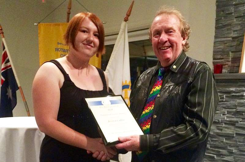 Rotary Club of Hall UC Scholarship winner Jessica Catlin is presented with a certificate by RC Hall Vice President Bernie Rogers