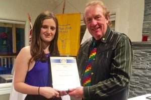 Rotary Club of Hall UC Scholarship winner Kira Copeland is presented with a certificate by RC Hall Vice President Bernie Rogers