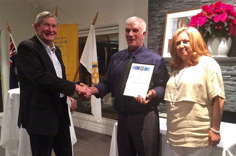 Mick and Rosa Addinno receive the Vocational Award from Rotary Club of Hall's Tony Howard