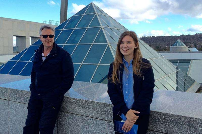 Martta and her first host dad Chris on the roof of Parliament House Canberra
