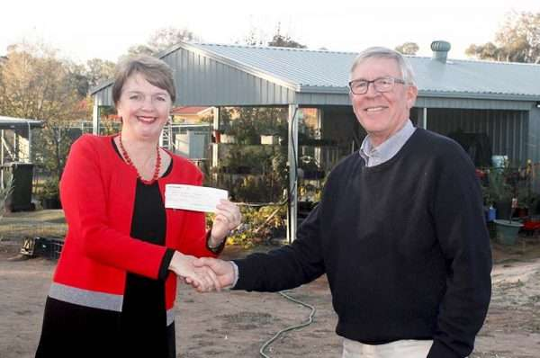 Roger Powell presents a cheque to MULCH