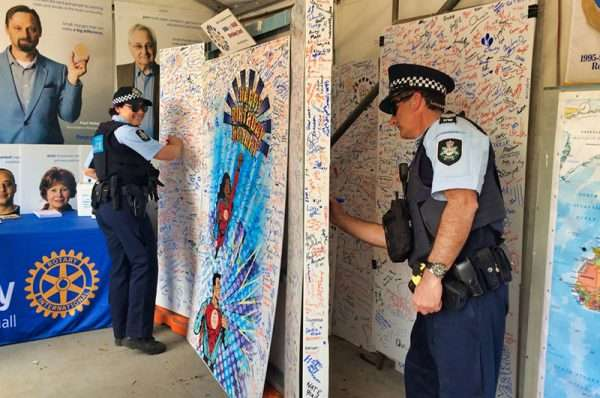Federal Police sign rotary 90 birthday card at Floriade